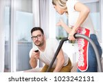 young man with remote control...   Shutterstock . vector #1023242131