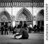 Small photo of FRANCE. PARIS - OCTOBER 1, 2016: Tourists visiting the Cathedrale Notre Dame de Paris is a most famous cathedral (1163 - 1345) on the eastern half of the Cite Island.
