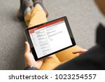 man reading email on tablet   Shutterstock . vector #1023254557