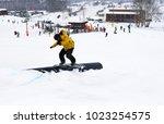Small photo of Kivioli, Ida - Virumaa , Estonia , Februar 03 2018, Unknown snowboarder do slide trick on plastic pipe