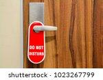 door of hotel room with sign... | Shutterstock . vector #1023267799