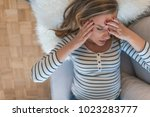 young woman suffering of... | Shutterstock . vector #1023283777