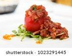 tuna tartar with tomato  rucola ... | Shutterstock . vector #1023291445
