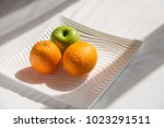 fresh green apple and oranges... | Shutterstock . vector #1023291511
