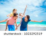 happy beautiful family on white ...   Shutterstock . vector #1023292519