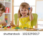 kids play with developmental... | Shutterstock . vector #1023293017