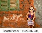 cute girl child wearing... | Shutterstock . vector #1023307231