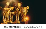 golden trophies on dark... | Shutterstock . vector #1023317344