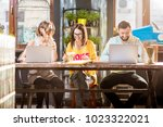 group of caucasian coworkers... | Shutterstock . vector #1023322021