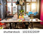 group of caucasian coworkers... | Shutterstock . vector #1023322039