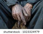 dirty hands of a steam... | Shutterstock . vector #1023324979