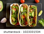 tacos with meat and vegetables... | Shutterstock . vector #1023331534