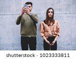 best friends standing on wall... | Shutterstock . vector #1023333811