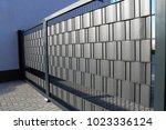 modern steel yard gate with... | Shutterstock . vector #1023336124