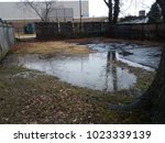 large water puddle in flooded...   Shutterstock . vector #1023339139