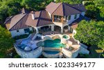 luxury mansion on large lot of... | Shutterstock . vector #1023349177