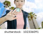 Businesswoman touch the virtual cloud button - stock photo