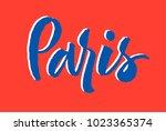 paris hand drawn lettering.... | Shutterstock .eps vector #1023365374