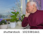 old lonely man sitting near the ... | Shutterstock . vector #1023381661