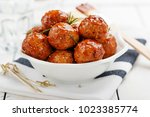 Chicken Meatballs with glaze on wooden table.