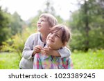 two sisters embracing on  ... | Shutterstock . vector #1023389245