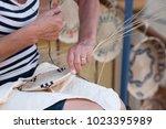 woman making handmade wicker... | Shutterstock . vector #1023395989
