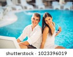 young cheerful loving couple... | Shutterstock . vector #1023396019