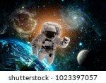 astronaut flies over the earth...   Shutterstock . vector #1023397057