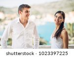 young couple visiting tropical... | Shutterstock . vector #1023397225
