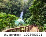 majestic waterfall in the... | Shutterstock . vector #1023403321