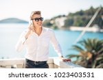 young handsome man enjoying... | Shutterstock . vector #1023403531