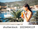 young female enjoying a... | Shutterstock . vector #1023404119
