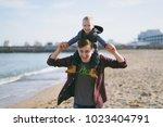 man playing at sea sand beach...   Shutterstock . vector #1023404791