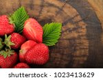 heap of strawberry on wooden... | Shutterstock . vector #1023413629