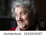 smile elderly woman face | Shutterstock . vector #1023414337