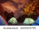 glowing tent in the mountains...   Shutterstock . vector #1023415735