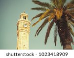 clock tower and palm tree on...   Shutterstock . vector #1023418909