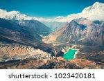 standing men with backpacks on... | Shutterstock . vector #1023420181