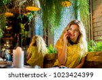 young charming woman calling... | Shutterstock . vector #1023424399