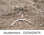 Cigarette Butts On The Beach....