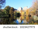 fall reflections in central... | Shutterstock . vector #1023427975