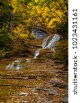 Small photo of A scenic, autumn view of cascades at Buttermilk Falls State Park in Ithaca, New York.