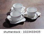 cups on plates | Shutterstock . vector #1023433435