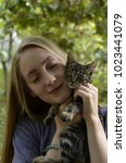 girl with the cat | Shutterstock . vector #1023441079