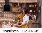 smiling african american... | Shutterstock . vector #1023442639