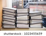 Small photo of Big stacks of files and documents organized in file boxes in an office