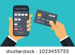 hand with credit card for... | Shutterstock .eps vector #1023455755