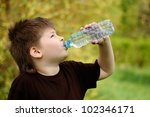 a boy with a bottle of water in ... | Shutterstock . vector #102346171