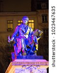 Small photo of Andre Marie Ampere illuminated statue during Fete des Lumieres in Lyon