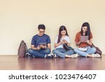 group of asian college student... | Shutterstock . vector #1023476407